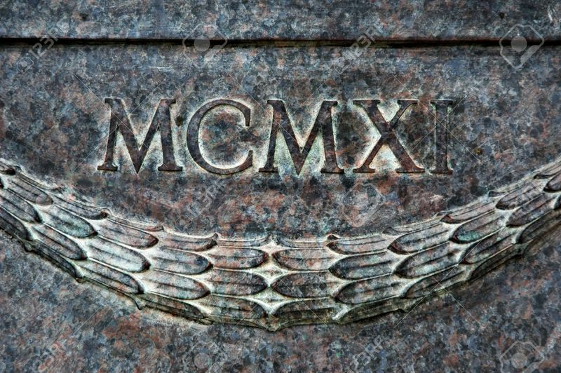 2422481-Roman-numeral-layered-with-textured-stone-in-Year-1911--Stock-Photo